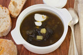 Mushroom soup with cream in white bowl — Stock Photo