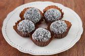 Chocolate truffles with coconut — Stock Photo