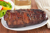 Baked pork on white dish — Stock Photo