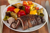 Rolled pork with sausage and vegetables — Stock Photo