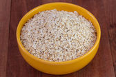 Oat flakes in the bowl — Stock Photo