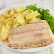 Flounder with vegetables on the plate — Stock Photo