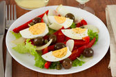 Salad with egg, onion and olives — Stock Photo