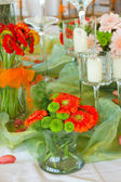 Decorated table with flowers — Stock Photo