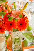 Flowers in vase on table — Stock Photo