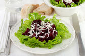 Boiled beet with lettuce and cheese — Stock Photo