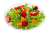 Fresh salad on the plate on white background — Stock Photo