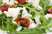 Rucola with cheese and tomato — Stock Photo