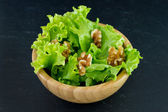 Salad with walnut in bowl — Stock Photo