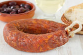 Sausage with olives and wine — Stock Photo
