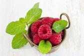 Raspberries with mint — Stock Photo