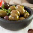 Olives in black bowl — Stock Photo