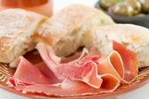 Prosciutto with bread — Stock Photo