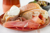 Prosciutto with bread — Stock Photo