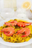 Shrimps with yellow rice — Stock Photo