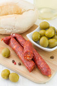 Sausages with olives and bread — Stock Photo