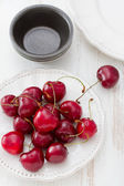 Cherry in white bowl — Stock Photo