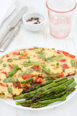 Omelette and asparagus — Stock Photo
