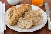 Bread with orange juice and jam — Stock Photo