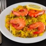 Постер, плакат: Rice with seafood and lemon