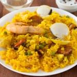 Постер, плакат: Rice with seafood in plate