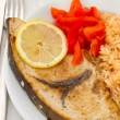 Fried fish with boiled rice on the plate — Stock Photo
