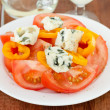 Tomato with pepper and cheese roquefort — Stock Photo