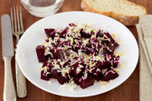Salad with beet, nuts and egg on white plate — Stock Photo