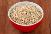 Pearl barley in red bowl — Stock Photo