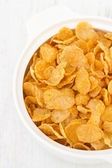 Corn flakes in bowl — ストック写真
