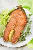 Salmon with salad on the white plate — Stock Photo