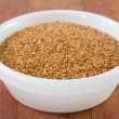 Linseed in white bowl — Stock Photo #33336869