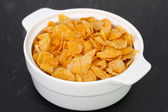 Cornflakes in white bowl — Stock Photo
