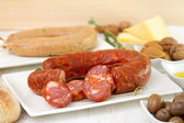 Sausages with bread and olive oil — Stock Photo