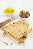 Toasts with olives and oil — Stock Photo