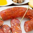 Smoked sausages with olives and oil — Stock Photo