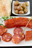 Smoked sausages with olives, bread — Stock Photo