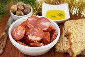 Chourico with olives and oil — Stock Photo