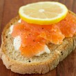 Toast with salmon and lemon — Stock Photo