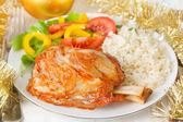 Pork with rice and salad — Stock Photo