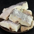 Salted dry codfish on brown plate — Stock Photo