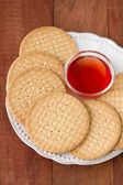 Cookies with jam on plate — Stock Photo