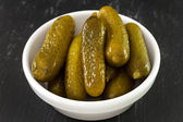 Salted cucumbers in bowl — Stock Photo