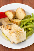 Cod fish with potato and beans — Stock Photo