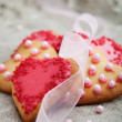Stock Photo: Pink heart shape cookies for Valentines Day celebration