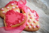 Pink heart shape cookies for Valentines Day celebration — Stock Photo