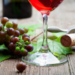Stock Photo: Grapes and red wine