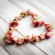 Heart from dry rose buds — Stock Photo