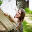 Woman relaxing in hammock — Stock Photo #48115231
