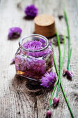 Chives blossom vinegar — Stock Photo